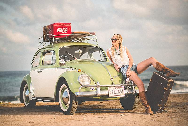 fashion shot of a woman in front of a volkswagen car for a fashion blog