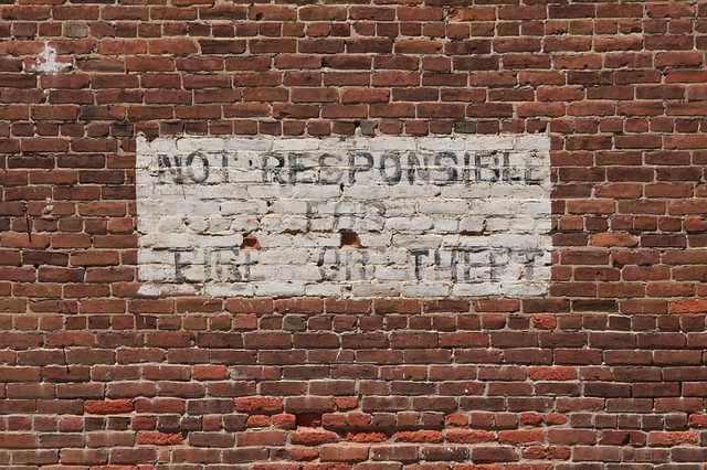 Disclaimer painted on brick wall