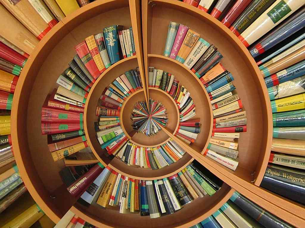 Circling bookshelf with books illustrating web links