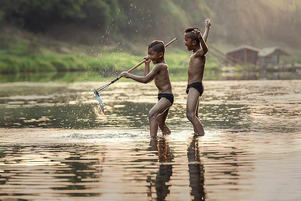 Young Asian boys fishing