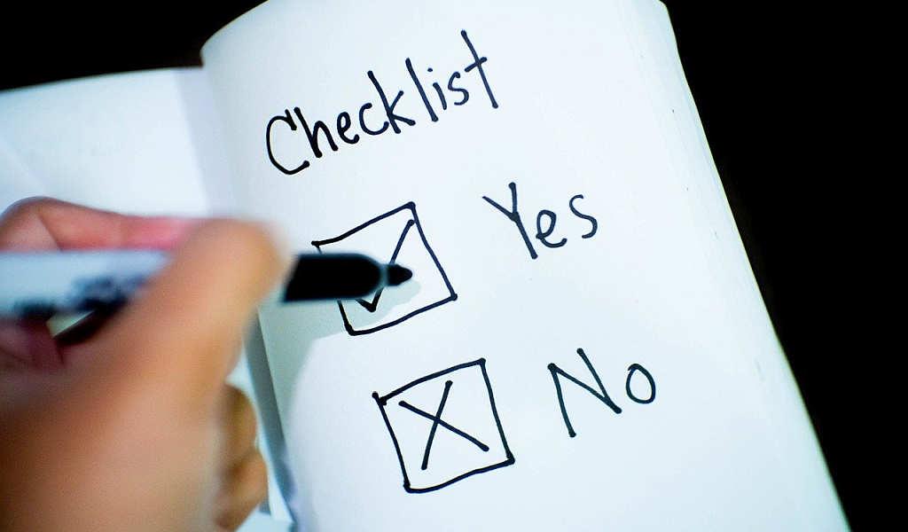 handwritten check list on papaer